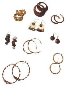 Nine neutral bold and different styles of pierced earrings. Beautiful for fall and winter.