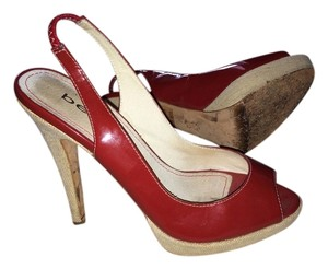 bebe Red Patent Pumps