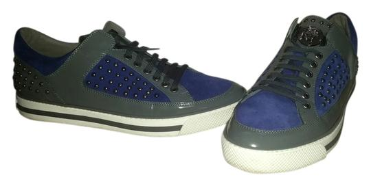 Preload https://img-static.tradesy.com/item/11616967/versace-men-s-leather-riveted-fashion-sneakers-blue-grey-flats-size-us-105-0-1-540-540.jpg