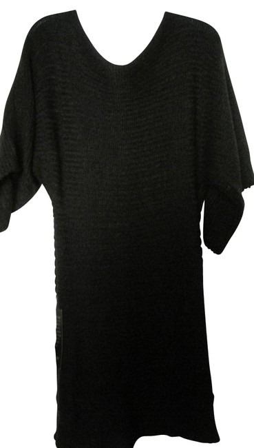 Preload https://item4.tradesy.com/images/bebe-black-cable-knit-sweater-dresstop-night-out-top-size-8-m-11628-0-0.jpg?width=400&height=650