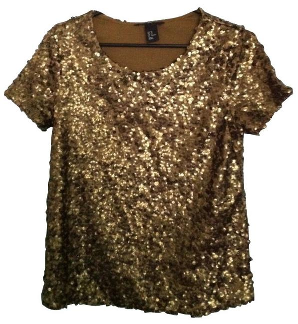 Preload https://item1.tradesy.com/images/h-and-m-gold-night-out-top-size-2-xs-1165-0-0.jpg?width=400&height=650