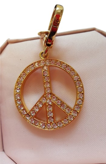 Preload https://img-static.tradesy.com/item/11655049/juicy-couture-gold-peace-charm-0-1-540-540.jpg