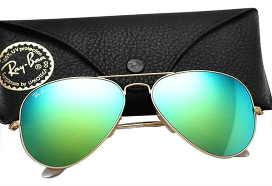 Preload https://item2.tradesy.com/images/ray-ban-green-aviator-rb3025-11219-matte-gold-w-mirror-lens-sunglasses-1165711-0-0.jpg?width=440&height=440