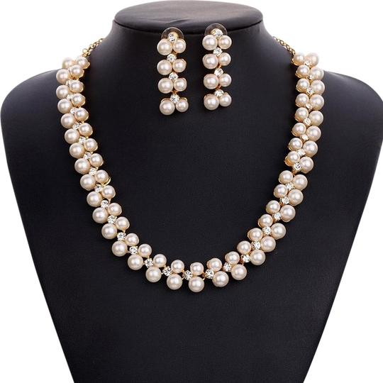 Preload https://img-static.tradesy.com/item/11671198/pearl-wedding-round-pave-cz-star-inspired-set-earring-necklace-0-1-540-540.jpg