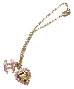 Chanel Authentic Chanel Gold Plated CC Heart Fuchsia Crystal Pendant Bracelet