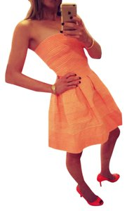 Akira short dress Neon tangerine on Tradesy