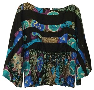 Alberto Makali Top Black with bright colors.