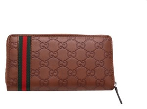 Gucci Gucci Brown Traditional Stripe Embossed Leather Wallet