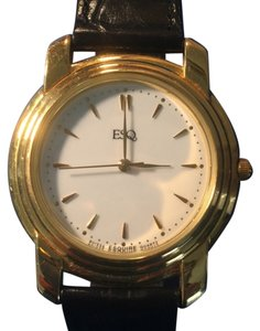 Movado ESQ Gold Watch with leather band. 300039