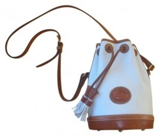 Preload https://item1.tradesy.com/images/dooney-and-bourke-vintage-drawstring-white-and-brown-leather-shoulder-bag-11720-0-0.jpg?width=440&height=440