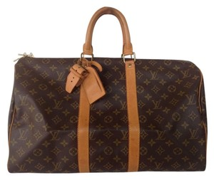 Louis Vuitton Brown monogrammed Travel Bag