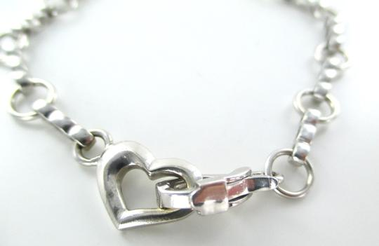 Other 14KT Solid White Gold Bracelet with a Heart Clasp