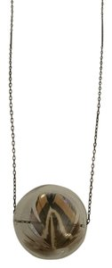 Anthropologie Anthropologie glass ball with feather suspended necklace