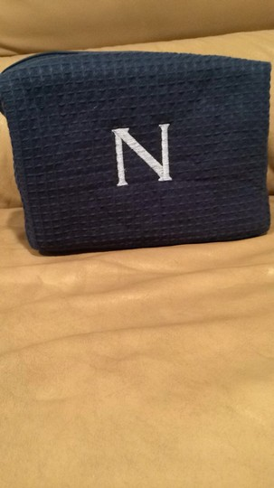 Navy travel bag monogrammed with light blue N