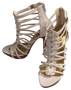 Bakers Zipper Stiletto White with gold stud details . Platforms
