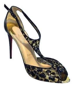 Christian Louboutin Tiny T Strap Black and gold Pumps