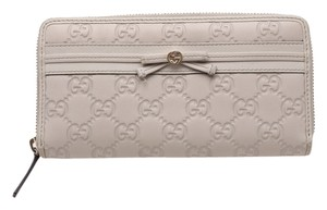 Gucci * Gucci GG Embossed Ivory Zip Around Wallet