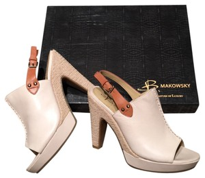 B. Makowsky Cream Platforms