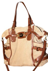 Michael Kors Tote in Natural canvas with dark brown leather accents.