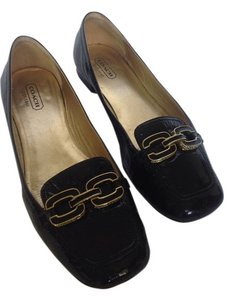 Coach Black and gold Flats