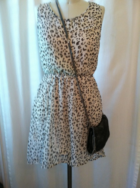 Divided by H&M short dress black, white Animal Print Sheer Cut-out Leopard on Tradesy