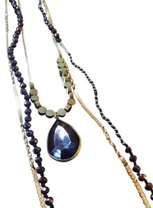 Anthropologie Triple strand necklace
