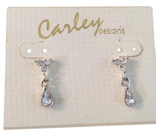 Carley Carley designs earrings