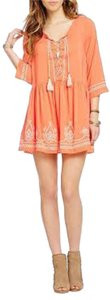 Coco and Jameson short dress Orange on Tradesy