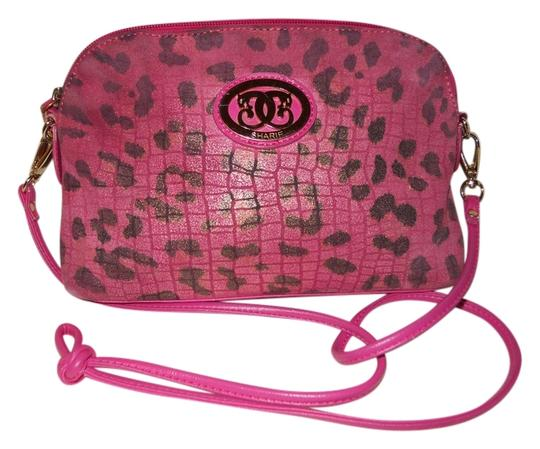 Preload https://item1.tradesy.com/images/sharif-leopard-print-pink-and-black-leather-with-man-made-trim-cross-body-bag-11987275-0-1.jpg?width=440&height=440