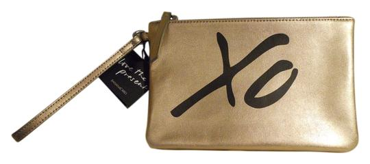 Preload https://item3.tradesy.com/images/banana-republic-xo-pouch-gold-and-black-leather-wristlet-11987917-0-1.jpg?width=440&height=440