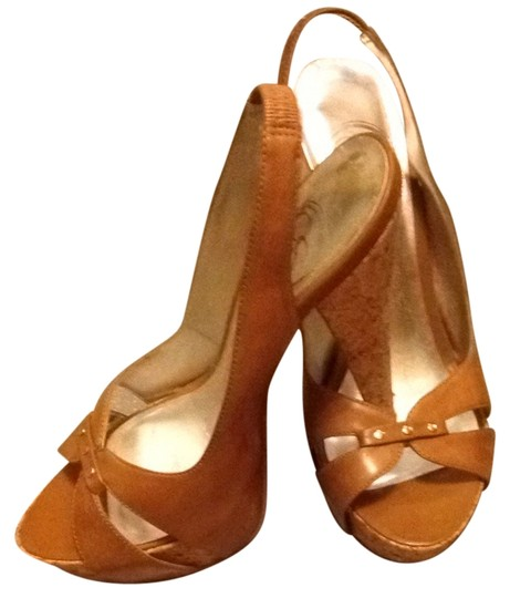 Preload https://item2.tradesy.com/images/jessica-simpson-brown-platforms-1198816-0-0.jpg?width=440&height=440