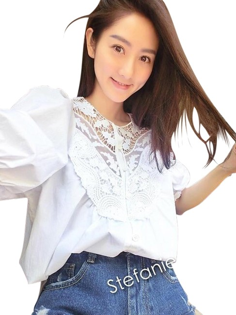 Preload https://item2.tradesy.com/images/white-blouse-size-os-one-size-11996146-0-4.jpg?width=400&height=650