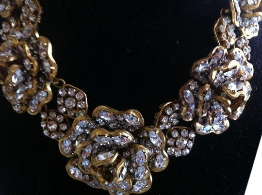 Preload https://img-static.tradesy.com/item/11998105/chanel-gold-vintage-16-strass-crystal-camellia-choker-circa-1970-1980-necklace-0-3-540-540.jpg
