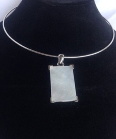 Carole Little Silver plated choker with pearlscent square pendant.