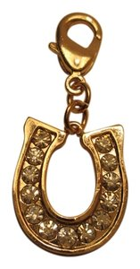 Juicy Couture Juicy Couture Good luck horse shoe Charm, gold color with jewels design all around. NWOT