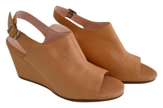 Preload https://item2.tradesy.com/images/taryn-rose-nude-wedges-size-us-65-regular-m-b-12006226-0-1.jpg?width=440&height=440