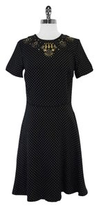 Marchesa Voyage short dress Black Gold on Tradesy