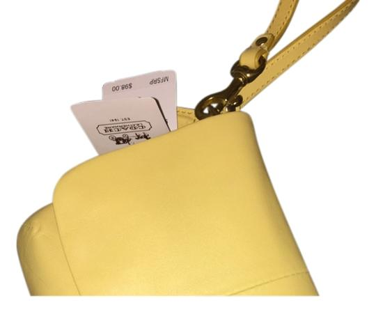 Preload https://item1.tradesy.com/images/coach-yellow-leather-clutch-12017170-0-1.jpg?width=440&height=440