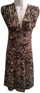 Norma Kamali short dress black and tan rose on Tradesy