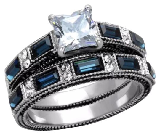Preload https://item2.tradesy.com/images/blue-and-clear-345tcw-and-2pc-cz-stainless-steel-wedding-set-ring-12021436-0-1.jpg?width=440&height=440