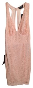 bebe short dress Peach Lace on Tradesy