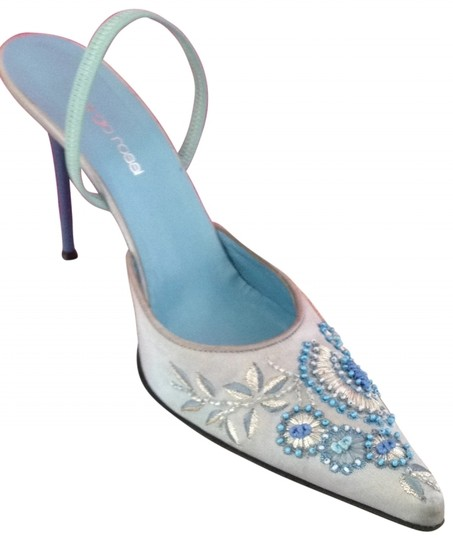 Preload https://item2.tradesy.com/images/sergio-rossi-blue-embroidered-just-reduced-pumps-size-us-9-regular-m-b-121906-0-0.jpg?width=440&height=440
