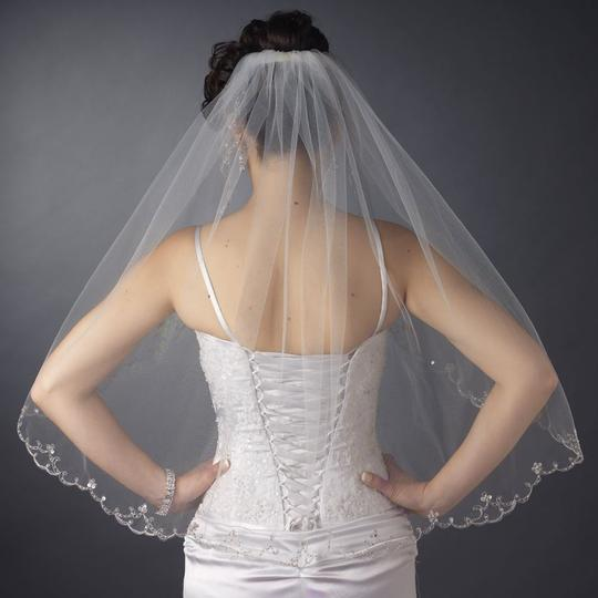 Preload https://item5.tradesy.com/images/elegance-by-carbonneau-white-elbow-length-wedding-veil-with-beaded-silver-embroidery-1219579-0-0.jpg?width=440&height=440