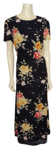 black background with multi-colored flowers Maxi Dress by Jennifer Moore