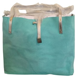 Tiffany & Co. Co Handbags Accessories Accessories Suede Reversible Makeup Turquoise Handbag Cute Fashionable New Vintage Tote in tiffany blue/silver metallic leather