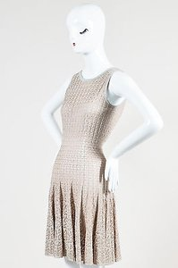 ALAÏA short dress Beige Alaia Silver Tone Crochet Metallic Sheer V Back Flared Sl on Tradesy