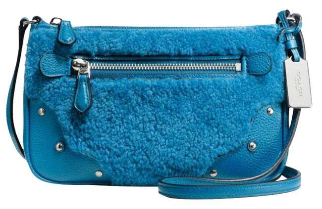 Coach Swingpack Rhyder ** Small Pouchette Peacock / Blue Leather / Shearling Cross Body Bag Coach Swingpack Rhyder ** Small Pouchette Peacock / Blue Leather / Shearling Cross Body Bag Image 1