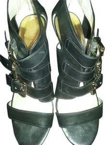 Michael Kors Black leather with gold trim buckles Sandals