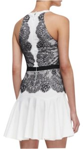 BCBGMAXAZRIA short dress White with black lace on Tradesy