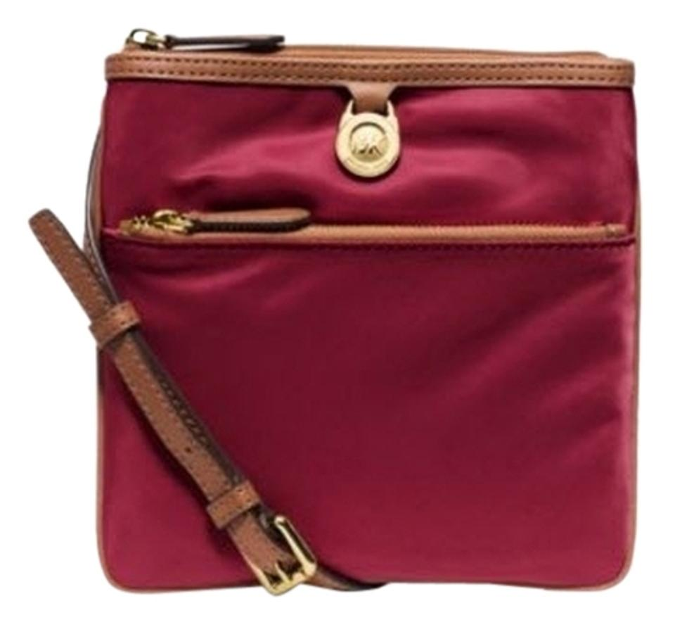 a86ffb1c5a00ad Michael Kors Kempton Large Nylon Red Leather Cross Body Bag - Tradesy